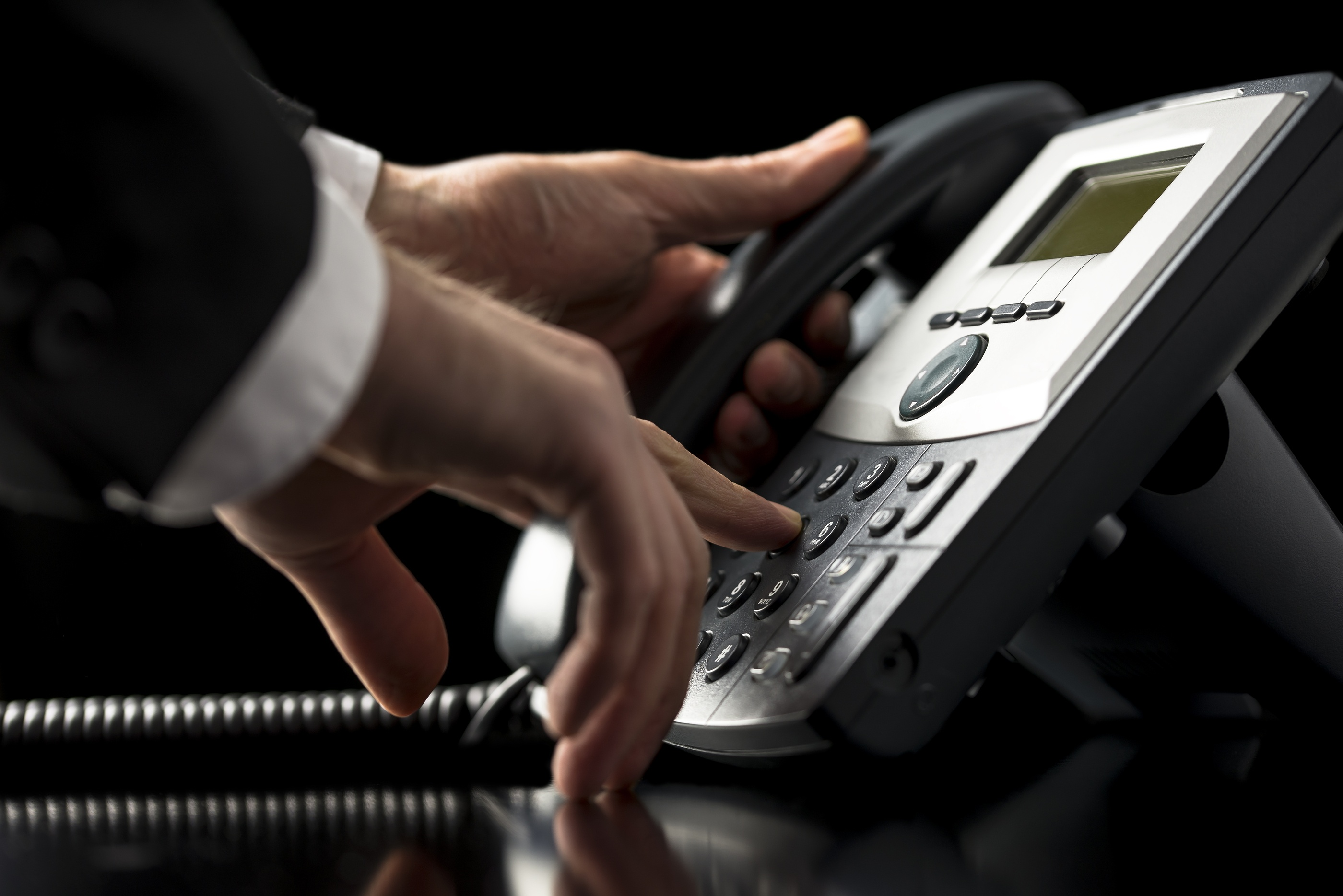 bigstock-Businessman-Dialling-Out-On-A--58088183.jpg